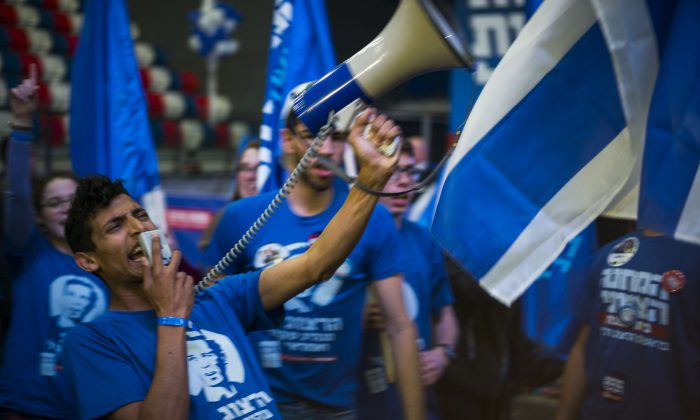 Supporters of the Zionist Union party react to preliminary election results on March 17, 2015 in Tel Aviv, Israel. (Ilia Yefimovich/Getty Images)