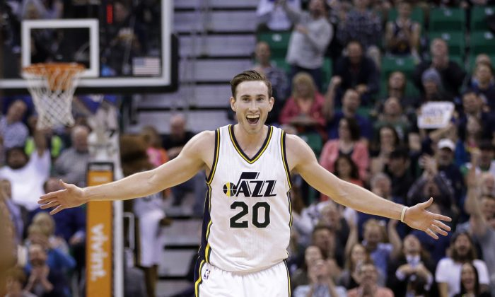 Utah Jazz forward Gordon Hayward celebrates after a teammate scored in the third quarter of an NBA basketball game against the Houston Rockets, Thursday, March 12, 2015, in Salt Lake City. The Jazz won 109-91. (AP Photo/Rick Bowmer)