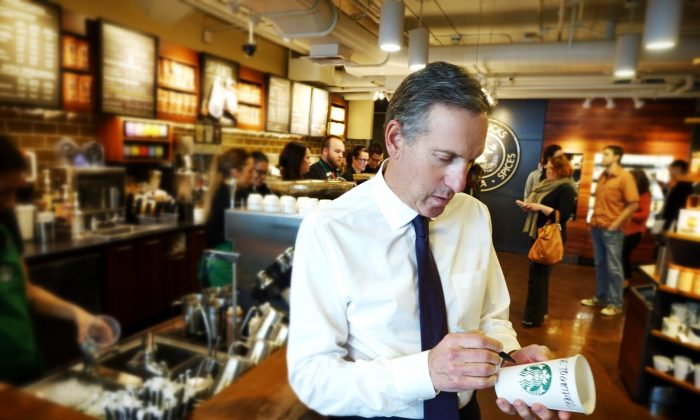 Starbucks CEO Howard Schultz, writes RaceTogether on a cup in a store in Seattle. (Starbucks Corporation)
