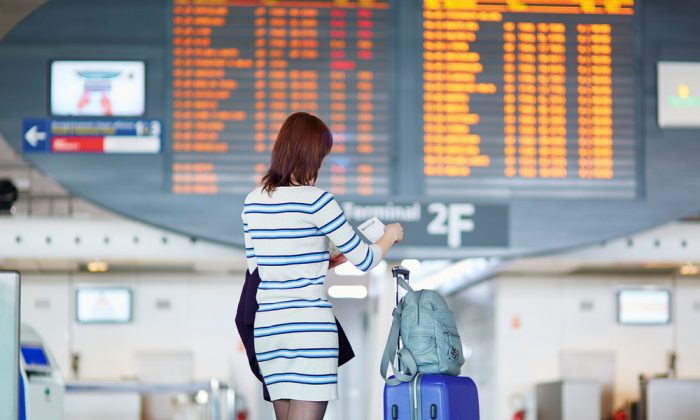 A young female passenger at the airport via Shutterstock*