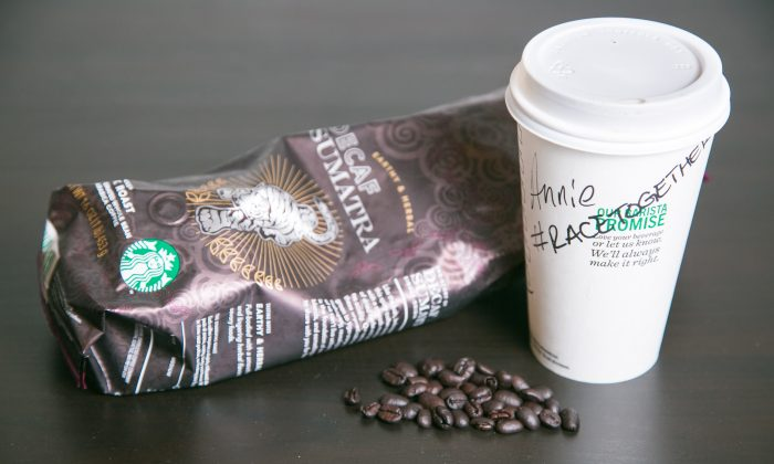 Starbucks is encouraging its baristas to start up conversations about race relations with its customers, by writing the hashtag, #RaceTogether on their coffee cups. (Benjamin Chasteen/Epoch Times)
