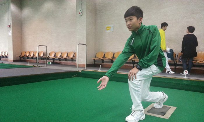 Marcus Tse won his first lawn bowls trophy after prevailing victorious at the final of the Youth Novice competition, at Ap Lei Chau Sports Complex last Sunday, Mar 15, 2015. (Howard Poon)