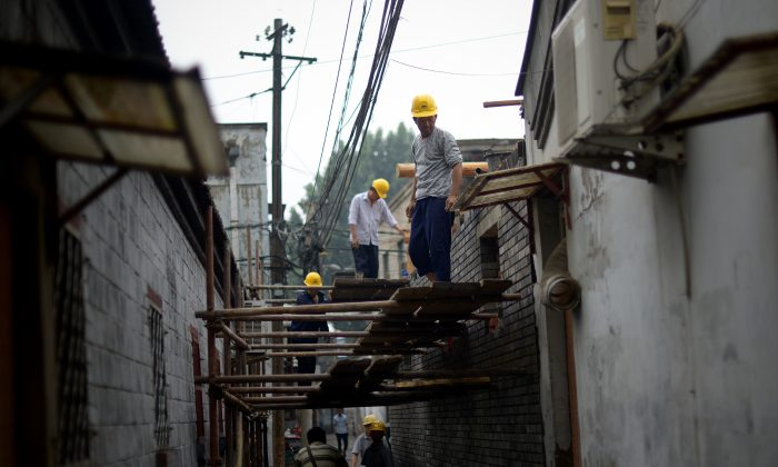 A group of Chinese workers build a house in an alley in Beijing on May 24, 2014. (Wang Zhao/AFP/Getty Images)