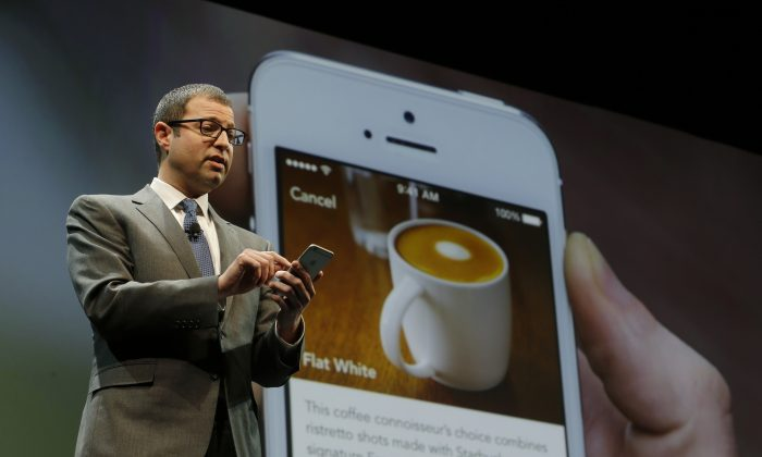 Adam Brotman, Starbucks chief digital officer, talks about the company's new mobile ordering app in Seattle on March 18, 2015. (AP Photo/Ted S. Warren)