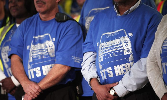 Ford workers at an event to celebrate the production launch of the all-new 2015 Ford F-150 truck in Dearborn, Michigan, on Nov. 11, 2014. (Bill Pugliano/Getty Images)