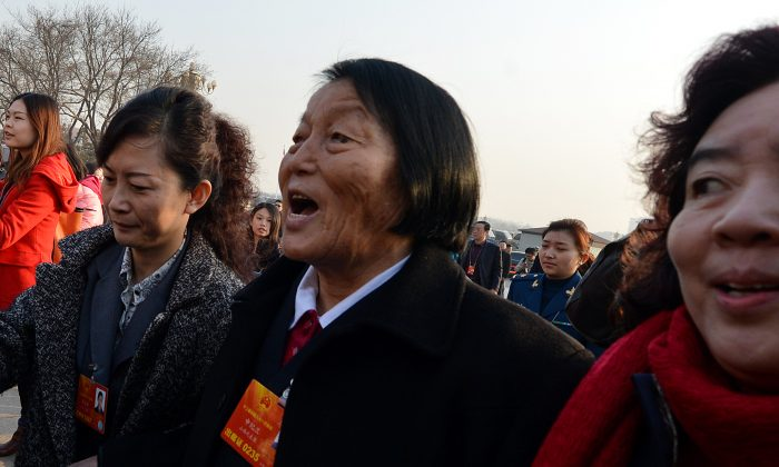 Caption: Shen Jilan arrives for the opening session of the National People's Congress at the Great Hall of the People in Beijing on March 5, 2013. (Mark Ralston/AFP/Getty Images)