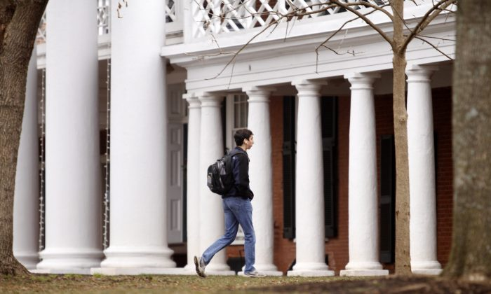 A fourth year student at the University of Virginia, walks across campus on December 6, 2014 in Charlottesville, Virginia. (Jay Paul/Getty Images)