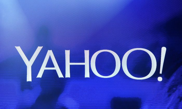 A Yahoo logo is shown on a screen during a keynote address by Yahoo President and CEO Marissa Mayer at the 2014 International CES at The Las Vegas Hotel & Casino on January 7, 2014 in Las Vegas, Nevada. (Ethan Miller/Getty Images)