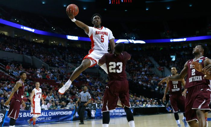 Stanley Johnson #5 of the Arizona Wildcats puts up a shot over Jason Carter #23 of the Texas Southern Tigers in the first half during the second round of the 2015 NCAA Men's Basketball Tournament at Moda Center on March 19, 2015 in Portland, Oregon. (Photo by Jonathan Ferrey/Getty Images)