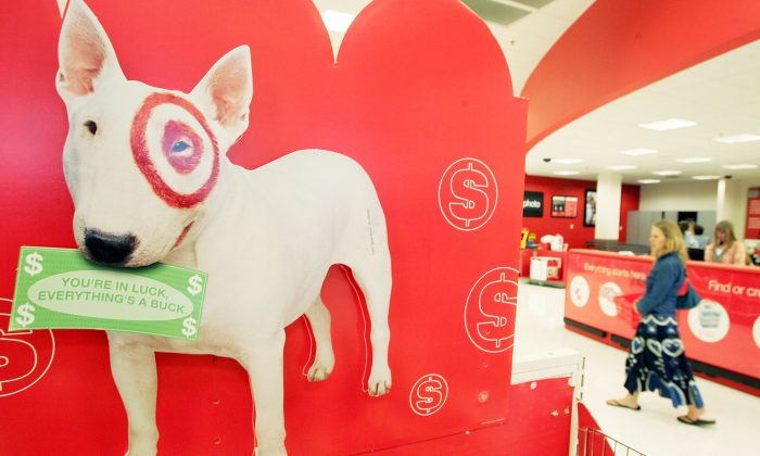 A sign with the Target dog mascot is seen inside a Target store in Albany, Ca., on May 15, 2006. (Photo by Justin Sullivan/Getty Images)