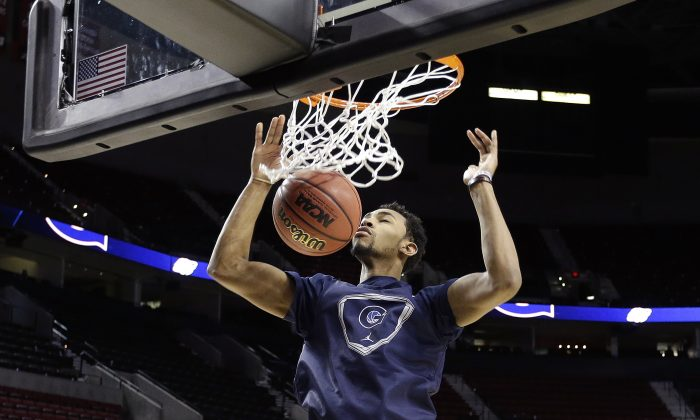 Georgetown forward Isaac Copeland scores during practice for an NCAA college basketball second-round game in Portland, Ore., Wednesday, March 18, 2015. Georgetown is to play Eastern Washington on Thursday. (AP Photo/Don Ryan)