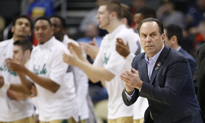 Notre Dame head coach Mike Brey works side court as his team plays against Northeastern during the second half of an NCAA tournament second round college basketball game, Thursday, March 19, 2015, in Pittsburgh. (AP Photo/Gene J. Puskar)