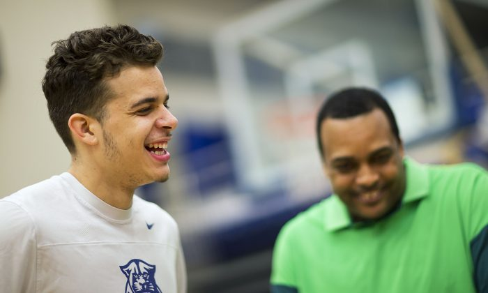 Georgia State's R.J. Hunter, left, laughs with his father and the team's head basketball coach Ron Hunter, right, while talking to the media, Monday, March 16, 2015, in Atlanta. (AP Photo/David Goldman)