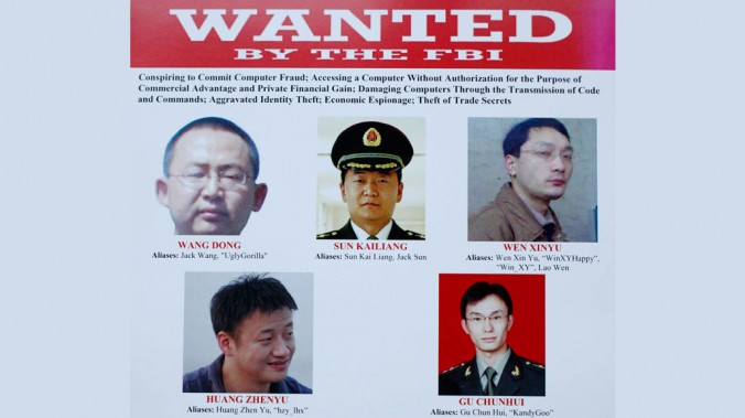 A wanted poster is displayed at the Justice Department in Washington on May 19, 2014, after U.S. authorities announced the indictment of five Chinese military hackers. The Chinese regime has now admitted the existence of its cyberwar units. (AP Photo)