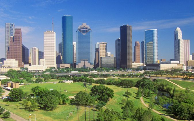 Houston skyline in the afternoon with Memorial Park in foreground in Texas via Shutterstock*