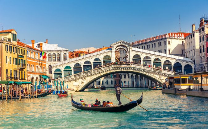 Gondola near Rialto Bridge in Venice, Italy via Shutterstock*