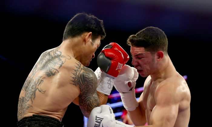 Julian Rodriguez punches Nyein Maung during their WBC Continental Americas Light Heavyweight title fight at Madison Square Garden on January 25, 2014 in New York City. (Elsa/Getty Images)