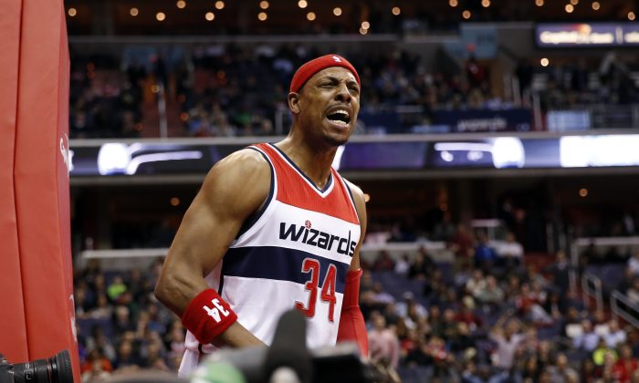 Washington Wizards forward Paul Pierce (34) disputes a foul call in the first half of an NBA basketball game against the Los Angeles Clippers, Friday, Dec. 12, 2014, in Washington. (AP Photo/Alex Brandon)