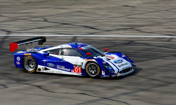Scott Dixon in the #01 Ganassi Riley-Ford EcoBoost led the Tudor Championship 12 Hours of Sebring at the halfway point. (Bill Kent/Epoch Times)