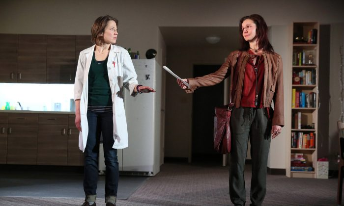 """(L) Louise (Carrie Coon) is a doctoral student working on new arousal drug. Neither she nor study participant, Mary (Florencia Lozano), know whether the trial sample that she is receiving is a placedo or the experimental drug, in the new play """"Placebo."""" (Joan Marcus)"""