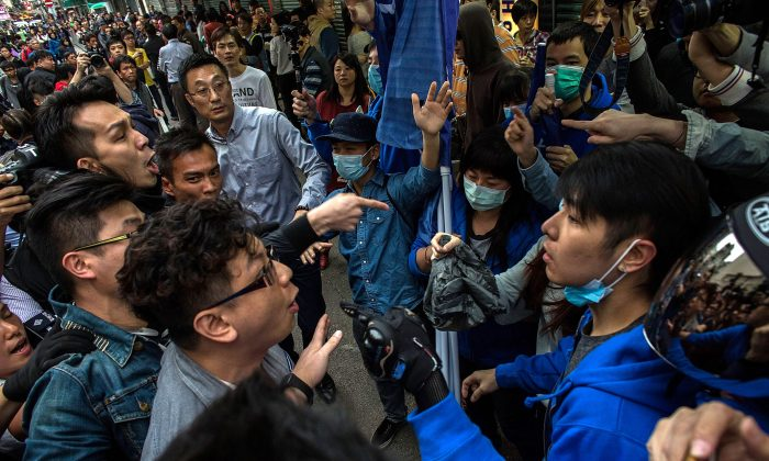 Protestors clash with pro-government supporters in Yuen Long during a rally against parallel-goods trading on Mar. 1, 2015 in Hong Kong. (Lam Yik Fei/Getty Images)
