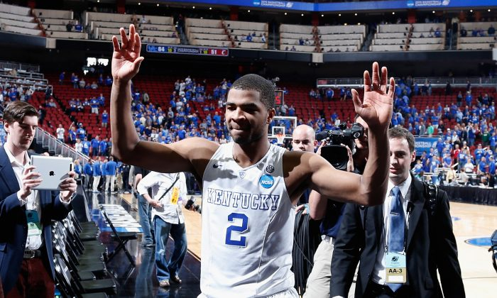 Aaron Harrison and the 36–0 Kentucky Wildcats are prohibitive favorites to win the title. (Joe Robbins/Getty Images)