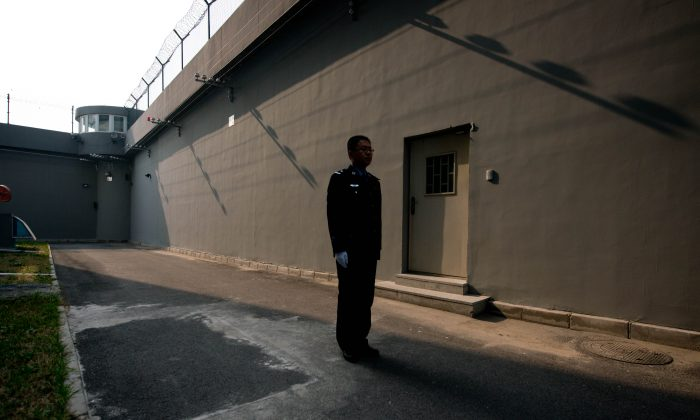 A guard in a courtyard inside the No.1 Detention Center in Beijing on Oct. 25, 2012. (Ed Jones/AFP/Getty Images)