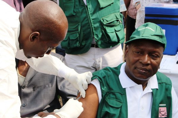 A man gets vaccinated against the Ebola virus at a health center in Conakry, Guinea on March 10, 2015. (CELLOU BINANI/AFP/Getty Images)