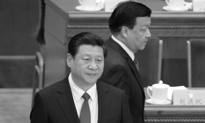 Liu Yunshan (top), walks past Chinese president Xi Jinping at the Great Hall of the People on March 3, 2014. A Hong Kong media reveals the wealth of the seven most powerful officials in China. (Wang Zhao/AFP/Getty Images)