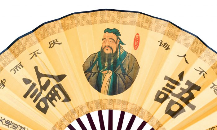 "A portrait of Confucius decorates a Chinese folding fan. In the ""Analects (論語) of Confucius,"" the sage advised rulers, ""To govern a large country, handle affairs in a prudent and serious manner and always be sincere, honest, and trustworthy."" (Fotolia)"