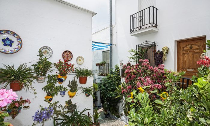 A yard with flowers in the Mijas town, Spain via Shutterstock*