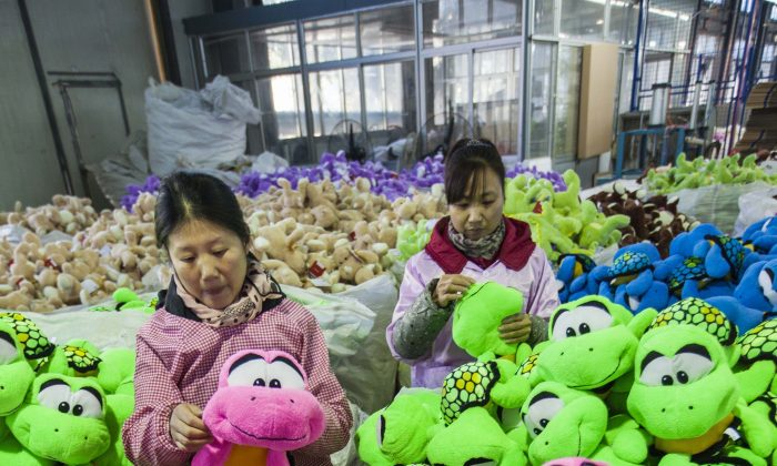 Workers manufactures toys for overseas export on December 8, 2014 in Lianyungang, Jiangsu province of China. Most of the dangerous non-food products identified by a European Union agency last year were made in China, a March 23 European Commision press release says.(ChinaFotoPress/ChinaFotoPress via Getty Images)