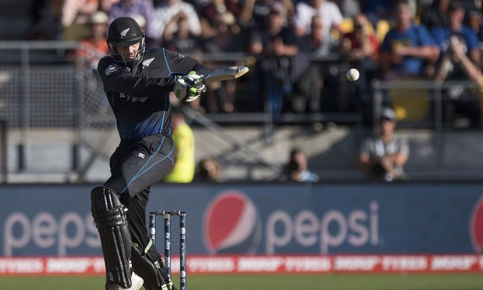 New Zealand batsman Martin Guptill plays a shot during the Cricket World Cup quarter-final match between New Zealand and the West Indies at Wellington Regional Stadium in Wellington on March 21, 2015. (Marty Melville/AFP/Getty Images)