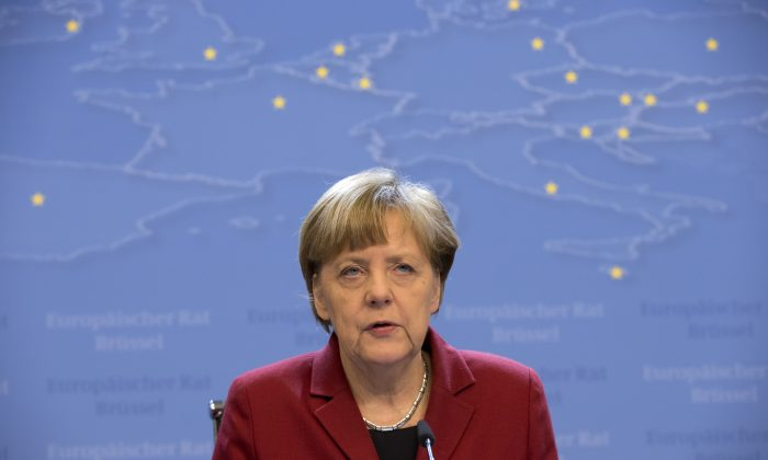 German Chancellor Angela Merkel delivers during a press conference following a round table meeting on Greece with Greek Prime Minister Alexis Tsipras at the EU summit in Brussels, Friday, March 20, 2015. (AP/Francois Mori)