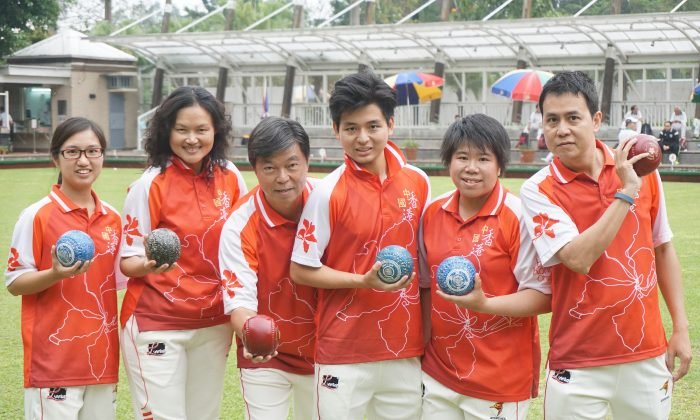 GO FOR IT—The new look Hong Kong team who will challenge for honour at the 3rd Chinese National Lawn Bowls Championship in Guangzhou this week (March 26-28). Team members includes (from left) Amy Choy (Manageress), Helen Cheung, Timmy Kwong, Ken KK Chan, Vivian Yip and Claudius Lam (Manager). (Michael Cheung)