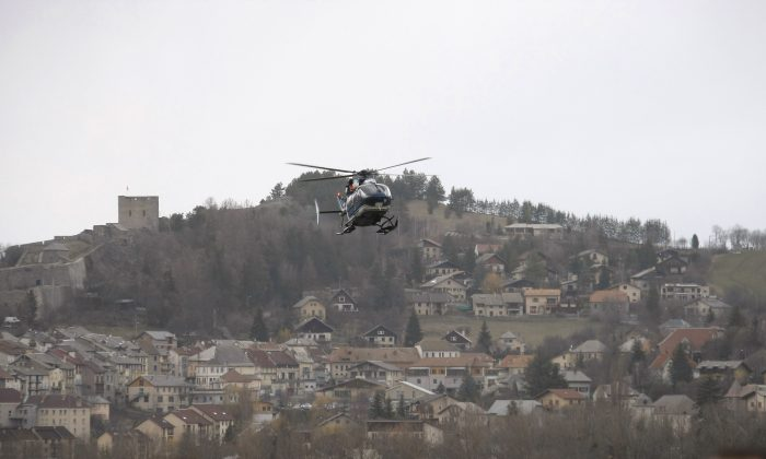 The first video footage appears to capture the Germanwings crash site in the French Alps. (AP Photo/Claude Paris)