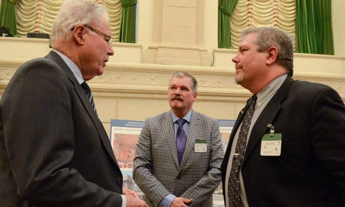 (L-R) Conservative MP Ray Boughen speaks with Peter Costello and Bill Crawford of the Mississauga-based Eden Community Food Bank after they testified before Parliament's human resources and social development committee on March 24, 2015. (Matthew Little/Epoch Times)