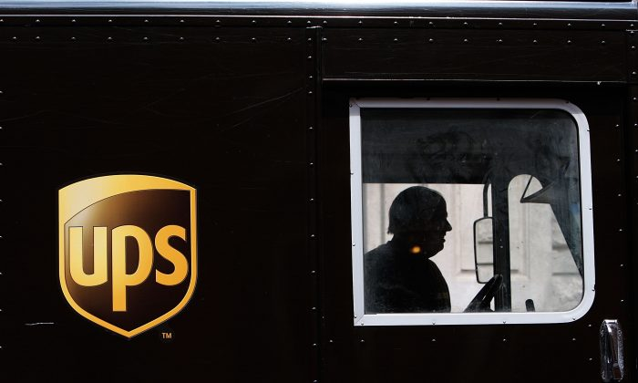 A UPS delivery driver sits in his truck April 23, 2009 in New York City. (Chris Hondros/Getty Images)
