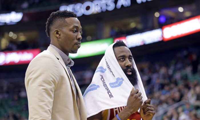 Houston Rockets' James Harden, right, and Dwight Howard walk back to the bench late the fourth quarter of an NBA basketball game against the Utah Jazz on Thursday, March 12, 2015, in Salt Lake City. The Jazz won 109-91. (AP Photo/Rick Bowmer)