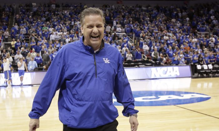 Kentucky head coach John Calipari jokes around with members of the media during practice for an NCAA college basketball second round game in Louisville, Ky., Wednesday, March 18, 2015. (AP Photo/David Stephenson)