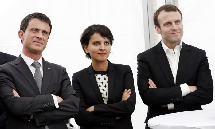 French Prime Minister Manuel Valls (L), French Economy and Industry minister Emmanuel Macron (R), and French Minister of Education Najat Vallaud-Belkacem in Bourg-Saint-Andeol, eastern France, as part of the campaign for the upcoming departmental elections, on March 20, 2015. (Philippe Merle/AFP/Getty Images)