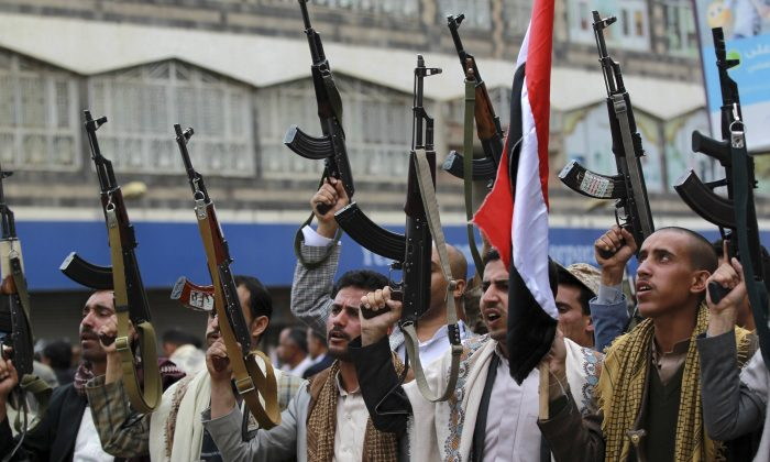 Shiite rebels, known as Houthis, hold up their weapons to protest against Saudi-led airstrikes, during a rally in Sanaa, Yemen, Thursday, March 26, 2015. (AP Photo/Hani Mohammed)