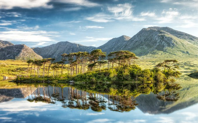 Derryclare Lough, Connemara mountains in the background in Ireland via Shutterstock*