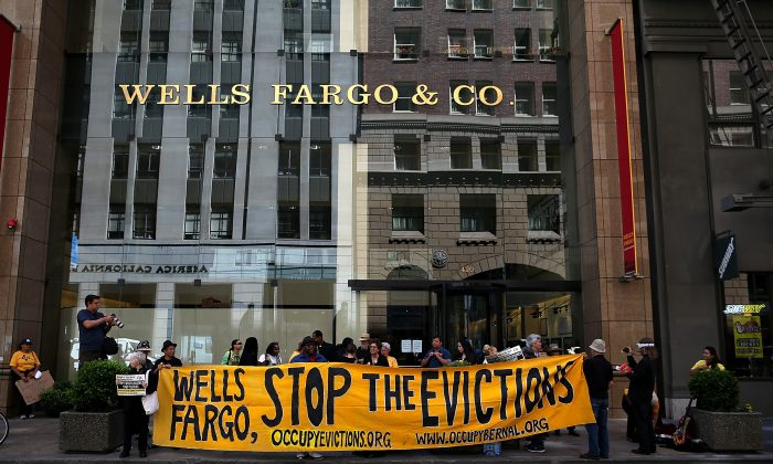 Protesters outside of the Wells Fargo headquarters in San Francisco on April 23, 2013. A few dozen protested to support those who have lost their homes to foreclosure because of Wells Fargo's lending practices. (Photo by Justin Sullivan/Getty Images)
