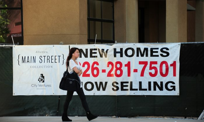 An advertising banner for new home sales in Alhambra, Calif., on Sept. 26, 2013. (Frederic J. Brown/AFP/Getty Images)