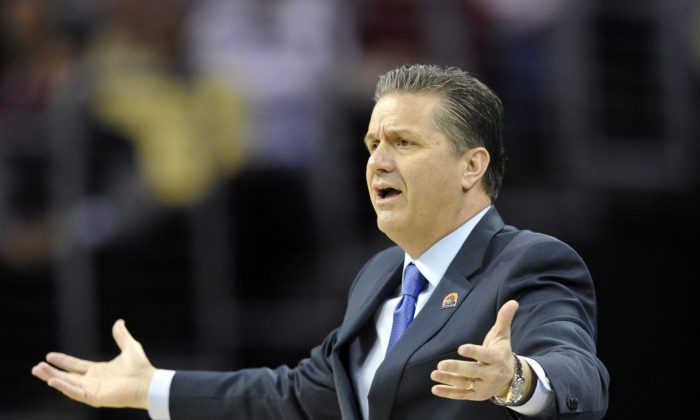 Kentucky head coach John Calipari in action in the first half of a college basketball game against West Virginia in the NCAA men's tournament regional semifinals, Thursday, March 26, 2015, in Cleveland. (AP Photo/David Richard)