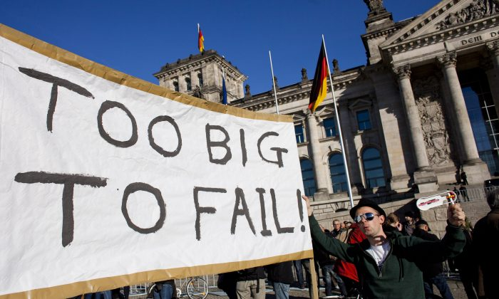 Protesters demonstrating against the influence of bankers and FINANCIERS in front of the Reichstag building in Berlin on Oct. 15, 2011. (Carsten Koall/Getty Images)