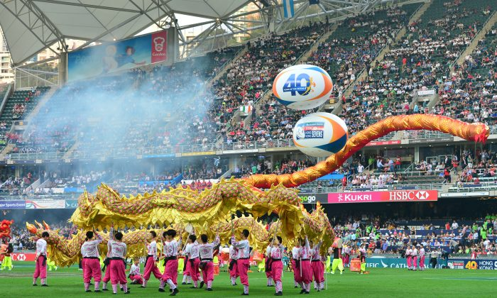 Dragons, drums and firecrackers open the 40th Hong Kong Sevens on Friday March 27, 2015. (Bill Cox/Epoch Times)