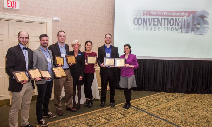 Michelle Rea, Executive Director of NYPPA (C) and staff members from the Epoch Times, hold eight first place awards and one John J. Evans award for Advertising Excellence, won at the 2015 New York Press Association and Trade show in Saratoga Springs, N.Y., on March 28, 2015. (Jan Jekielek/Epoch Times)
