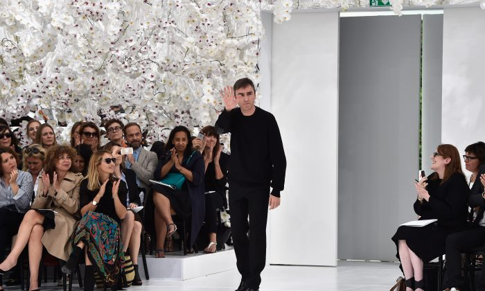 Designer Raf Simons acknowledges the applause of the audience after the Christian Dior show as part of Paris Fashion Week - Haute Couture Fall/Winter 2014-2015 on July 7, 2014 in Paris, France.  (Pascal Le Segretain/Getty Images)